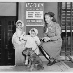Girl Scout Assists Voting Parents